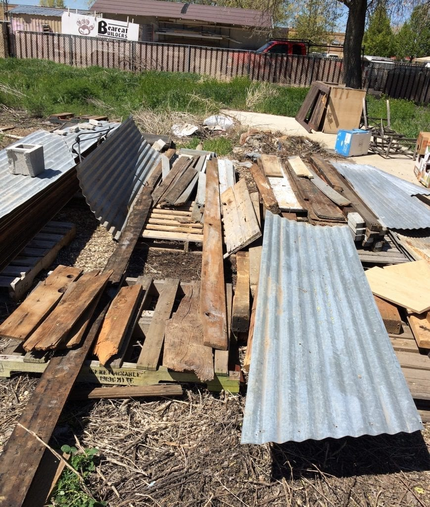 Pile of barnwood and metal tin roof outside