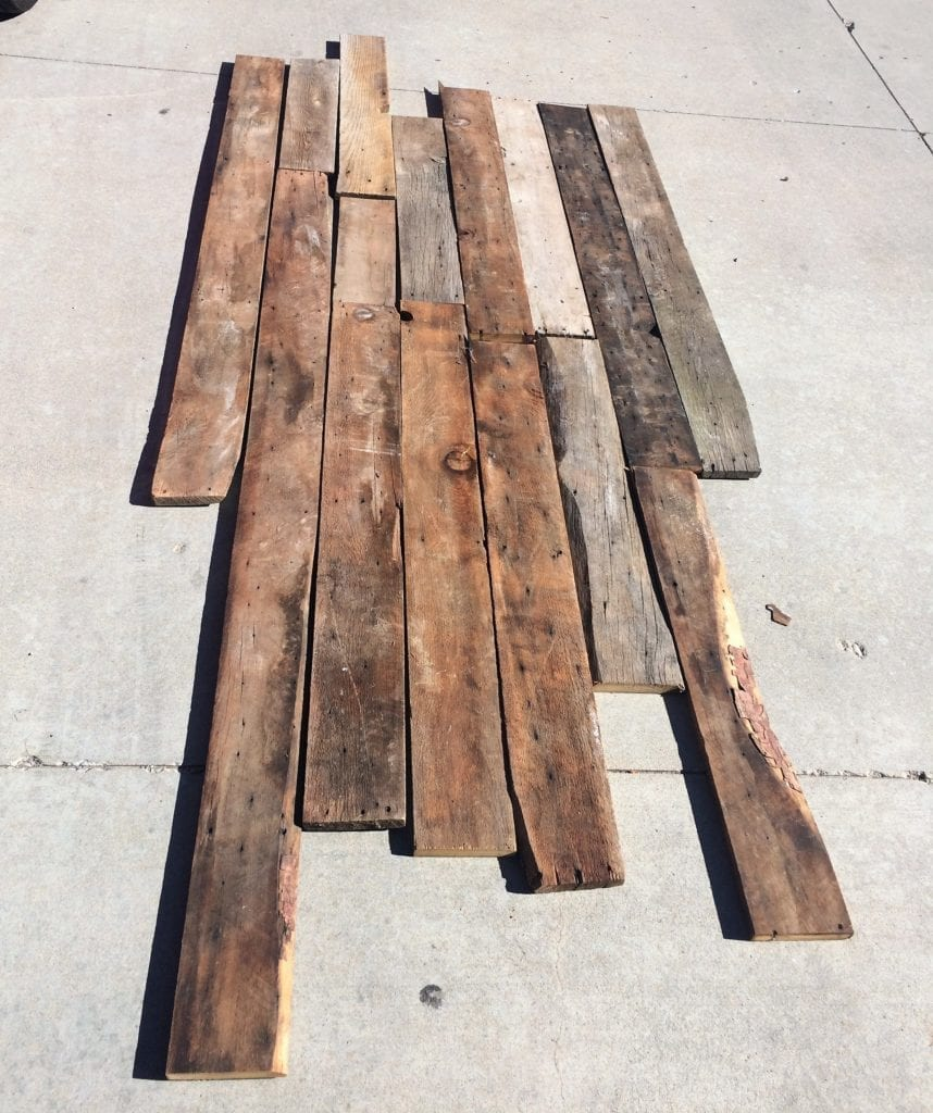 How to was reclaimed barn wood. Scrubbing wood with a push broom and soap and water mixture