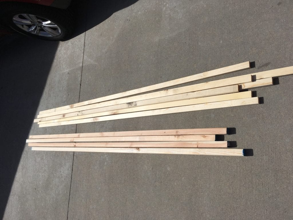 2x2s in a pile in the driveway to build DIY garden trellis