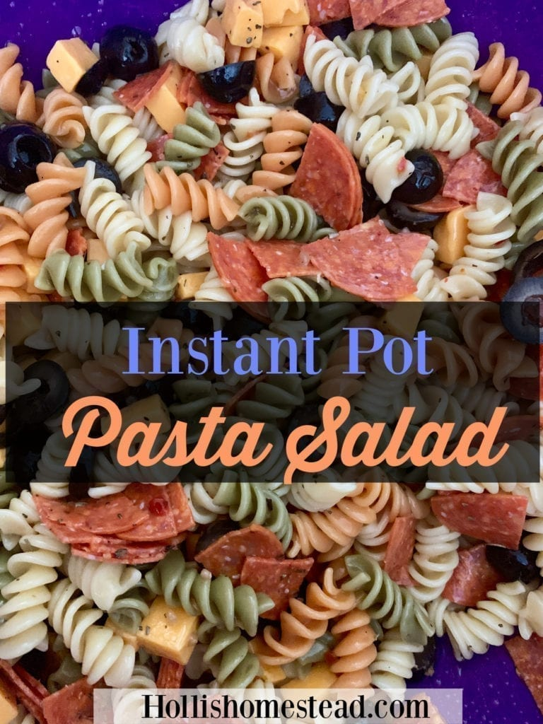 Instant Pot Pasta Salad with tri colored rotini, cheddar cheese, black olives, sliced pepperoni and Italian dressing