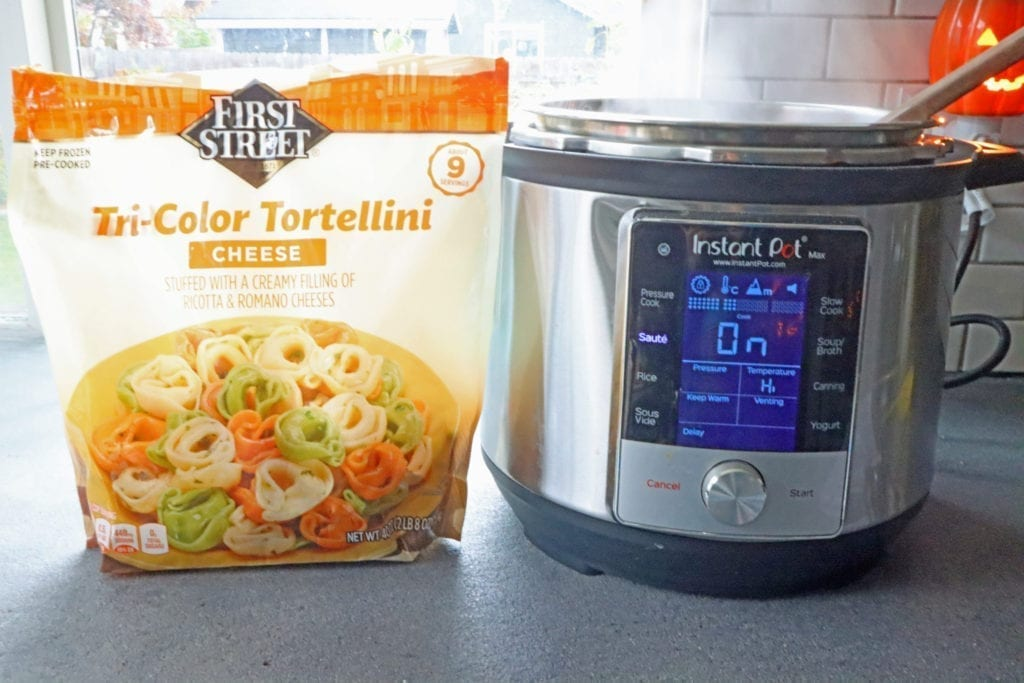 instant pot and bag of cheese tortellini next to it