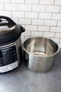 6 quart instant pot stainless steel inner liner sitting next to instant pot