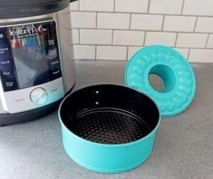 Teal Spring form bunt pan next to 6 quart instant pot