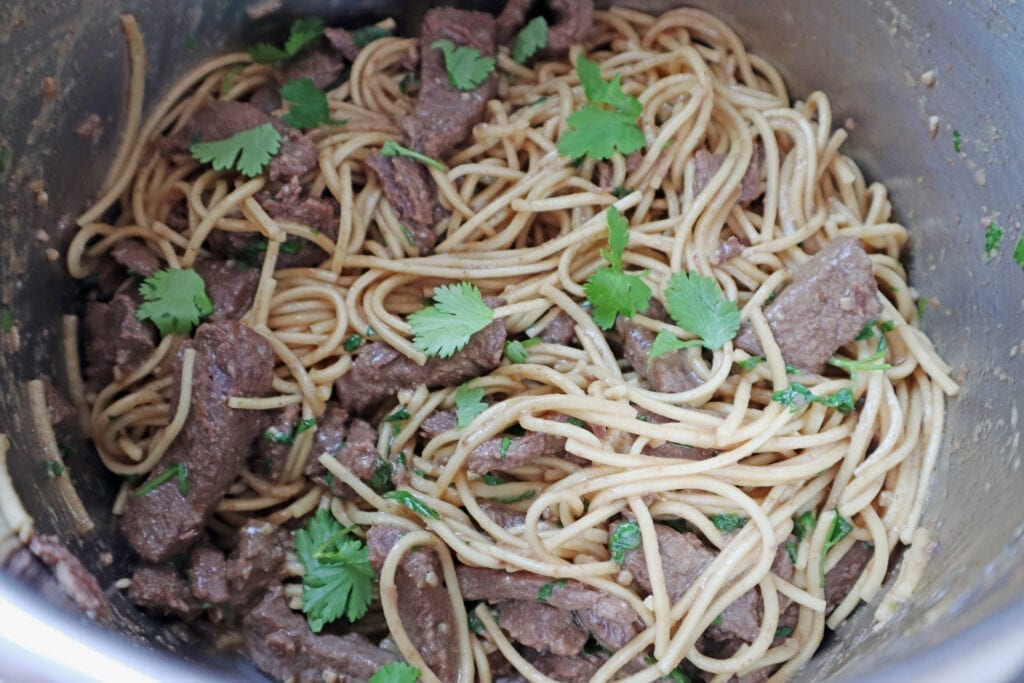 Garlic Sesame Noodles with Steak recipe in the instant pot with cilantro on top