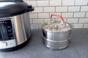 Stainless steel instant pot stackable pans for pot in pot cooking.