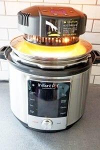Instant pot mealthy crisp air fry lid on top of 6 quart instant pot