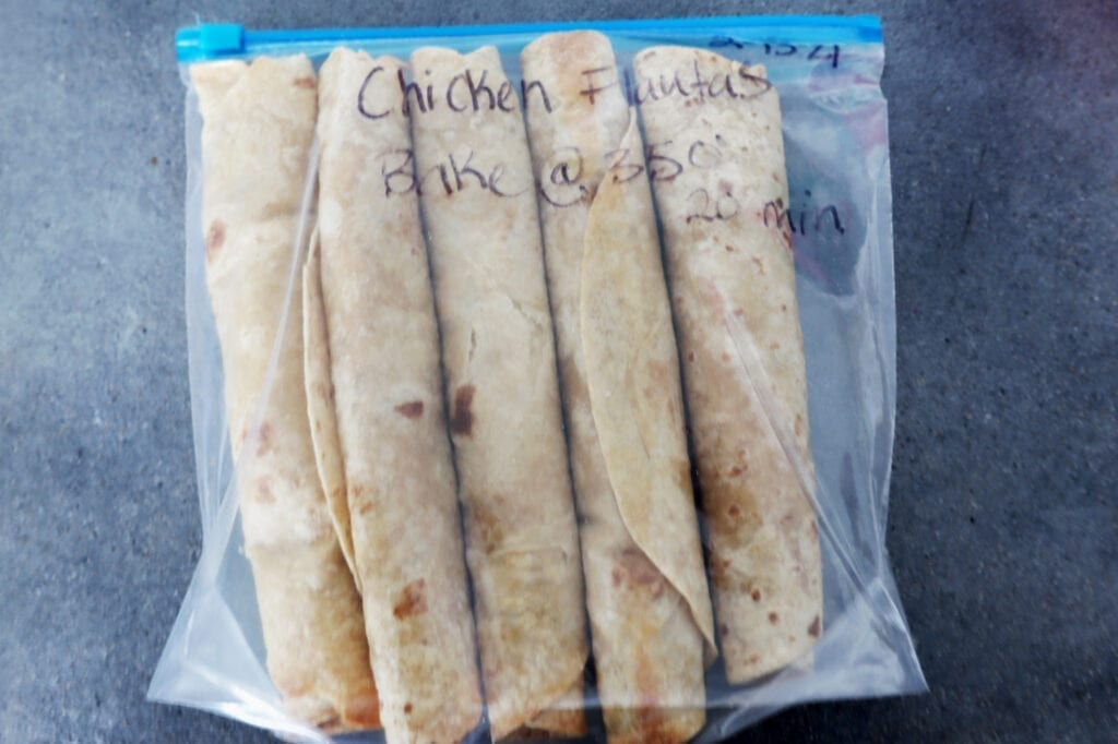 Frigidaire Air fried chicken flautas ingredients rolled up into whole wheat tortilla. Stored in a gallon freezer bag.