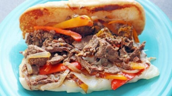 Philly cheesesteak Instant Pot recipe on a teal plate