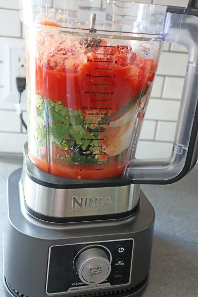 make quick and easy salsa for any occasion in as little as 5 minutes in a blender. Fresh Cilantro, onion, jalapenos, garlic, lime juice and canned tomatoes in the ninja blender.